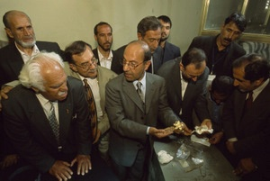 Minister of Information and Culture Sayeed Makhdoom Raheen (center) turns to Viktor Sarianidi (left, front) as the inventory team opens the first safe of Bactrian gold in the presidential bank vault, Kabul 2004 - © Kenneth Garrett, National Geographic Society