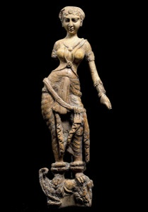 Cat. No. 148: Statuette of a woman standing on a makara, possibly a furniture ornament (Begram, Room 10), 1st-2nd centuries AD (ivory, 45.6 cm (17 15/16)) - National Museum of Afghanistan © Thierry Ollivier / Musée Guimet