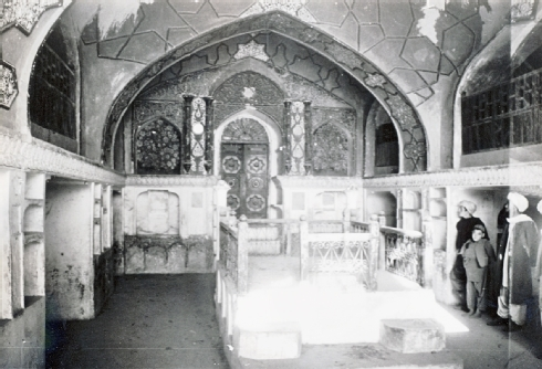 Fig. 6 The Mullah Garji, or Mullah Ashur Synagogue, in 1973 (now mostly in ruins); interior view showing the richly painted west wall with the aron ha-qodesh (ark) against the western wall - Courtesy of Werner Herberg, 1973